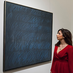 "© Licensed to London News Pictures. 08/04/2016. London, UK. A Sotheby's staff member views Cy Twombly's ""Untitled (New York City)"", 1968, est. $40million.  Sotheby's auction preview, at their New Bond Street gallery, of works to be in the upcoming New York Impressionist, modern and contemporary art sale. Photo credit : Stephen Chung/LNP"