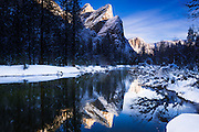 The Three Brothers above the Merced River in winter, Yosemite National Park, California USA