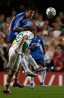 Photo: Daniel Hambury.<br />Chelsea v Werder Bremen. UEFA Champions League, Group A. 12/09/2006.<br />Chelsea's Frank Lampard beats Bremen's Pierre Wome to this header.