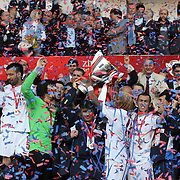 Jubilant Trabzonspor players Alan Carlos Gomes Da COSTA (L), Engin BAYTAR (2ndL), Umut BULUT (R), Rigobert Song BAHANAG (2ndR) lifting up the cup at the ceremony during their after the Turkey Cup final match Trabzonspor between Fenerbahce at the GAP Arena Stadium at Urfa Turkey on wednesday, 05 May 2010. Photo by TURKPIX