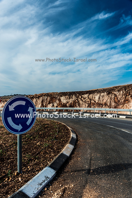 Roundabout and Safety metal guardrail on a rural roadside