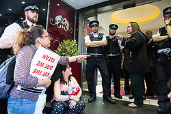 London, UK. 1 June, 2019. Dalia Quinonez Guerrero (l), a former cleaner at the DoubleTree Hilton Hotel from whom wages were withheld, speaks to Betty Ferro, who is responsible for outsourced cleaners working at the hotel,  during a protest by members of United Voices of the World (UVW) and Independent Workers of Great Britain (IWGB) trade unions in solidarity with her.