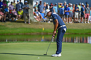 Si Woo Kim (KOR) sinks his putton 16 during 3rd round of the World Golf Championships - Bridgestone Invitational, at the Firestone Country Club, Akron, Ohio. 8/4/2018.<br /> Picture: Golffile | Ken Murray<br /> <br /> <br /> All photo usage must carry mandatory copyright credit (© Golffile | Ken Murray)