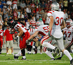 11.07.2011, UPC Arena, Graz, AUT, American Football WM 2011, Group B, Kanada (CAN) vs Oesterreich (AUT), im Bild Nick FitzGibbon (Canada, #34, RB) with the ball beeing followed by Christoph Schilcher (Austria, #55, LB) and Christof Promitzer (Austria, #30, DB) and Michael Suess (Austria, #47, LB)// during the American Football World Championship 2011 Group B game, Canada vs Austria, at UPC Arena, Graz, 2011-07-11, EXPA Pictures © 2011, PhotoCredit: EXPA/ E. Scheriau