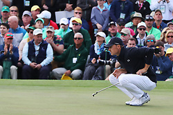 April 8, 2018 - Augusta, GA, USA - Jordan Spieth lines up his putt on the 18th green where he bogied to fall to 13 under for the round during the final round of the Masters at Augusta National Golf Club on Sunday, April 8, 2018, in Augusta, Ga. (Credit Image: © Curtis Compton/TNS via ZUMA Wire)