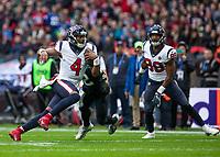 American Football - 2019 NFL Season (NFL International Series, London Games) - Houston Texans vs. Jacksonville Jaguars<br /> <br /> Deshaun Watson, Quarterback,(Houston Texans) chooses to run rather than throw at Wembley Stadium.<br /> <br /> COLORSPORT/DANIEL BEARHAM