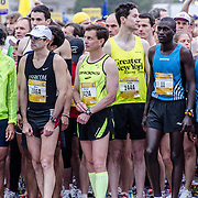 Some of the elite men runners on the start line just moments before the start of the 2012 Cherry Blossom 10-Miler. At right, in the number 9 bib, is the eventual winner, Allan Kiprono from Kenya, who set a new course record of 45:15. To his right, in number 11, is Lani Kiplagat, also from Kenya, who came second in 46:28. This year was the 40th running of the race that is run every spring in Washington DC to coincide with the National Cherry Blossom Festival. The course starts near the Washington Monument, heads over Memorial Bridge and back, goes up under the Kennedy Center, around the Tidal Basin and past the Jefferson Memorial, and then does a loop around Hains Point back to the finish near the Washington Monument.