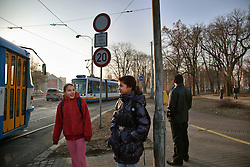 "Sára Danková, 12, walks with a friend to Zakladni Skola in Ostrava, Czech Republic on March 5, 2012. Her brother Peter Danko was one of 18 Roma children who were represented in the D.H. and Others v. Czech Republic case, the first challenge to systemic racial segregation in education to reach the European Court of Human Rights. When this case was first brought in 2000, Roma children in the Czech Republic were 27 times more likely to be placed in ""special schools,"" intended for the mentally disabled, than non-Roma children. In 2007, the Grand Chamber of the European Court of Human Rights ruled that this pattern of segregation violated nondiscrimination protections in the European Convention on Human Rights. Despite this landmark decision, little change has occurred: the ""special schools"" have been renamed but follow the same substandard curriculum and Roma continue to be assigned to these schools in disproportionate numbers. The process of integration has barely begun."