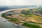 Nederland, Gelderland, Nijmegen, 26-06-2014; rivier de Waal met (de toerit naar ) de Waalbrug, gezien vanuit het Oosten, daarachter de spoorbrug met fietspad (De Snelbinder) en tenslotte de nieuwe stadsbrug van Nijmegen De Oversteek. Rechts van de rivier grondwerkzaamheden voor de dijkteruglegging Lent (Ruimte voor de Rivier). De dijken worden landinwaarts verplaats en er wordt een nevengeul gegraven. De huizen op de dijk blijven bestaan en komen te liggen op het Stadseiland Veur-Lent Nijmegen. <br /> First bridge the Waal bridge on the river Waal, next the railway bridge with cycle path De Snelbinder (The Luggage strap) and finally the new city bridge of Nijmegen De Oversteek (The Crossing). Right of the river groundwork for the Dike relocation of Lent (project Ruimte voor de Rivier: Room for the River).<br /> luchtfoto (toeslag op standaard tarieven);<br /> aerial photo (additional fee required);<br /> copyright foto/photo Siebe Swart.
