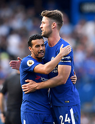 Chelsea's Pedro (left) and Chelsea's Gary Cahill hug at the end of the Premier League match at Stamford Bridge, London.