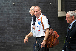 © Licensed to London News Pictures. 24/07/2018. London, UK. British diver Vern Unsworth (centre), who played a leading role in the operation to rescue a group of boys trapped in a cave in Thailand, arrives on Downing Street for a reception with the Prime Minister. Photo credit: Rob Pinney/LNP