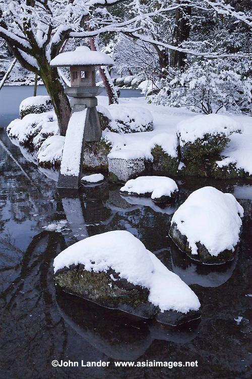 "Kotoji-toro, a stone lantern with two legs, said to resemble the bridge on a koto. This lantern is the symbol of Kenrokuen and Kanazawa.  Kenroku-en or the ""Six Attributes Garden"" (spaciousness, seclusion, artifice, antiquity, watercourses and panoramas)  along with Kairakuen and Korakuen, is one of the Three Great Gardens of Japan."