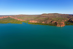 Mangroves meet sandstone cliffs on the Kimberley coast near the Hunter River.
