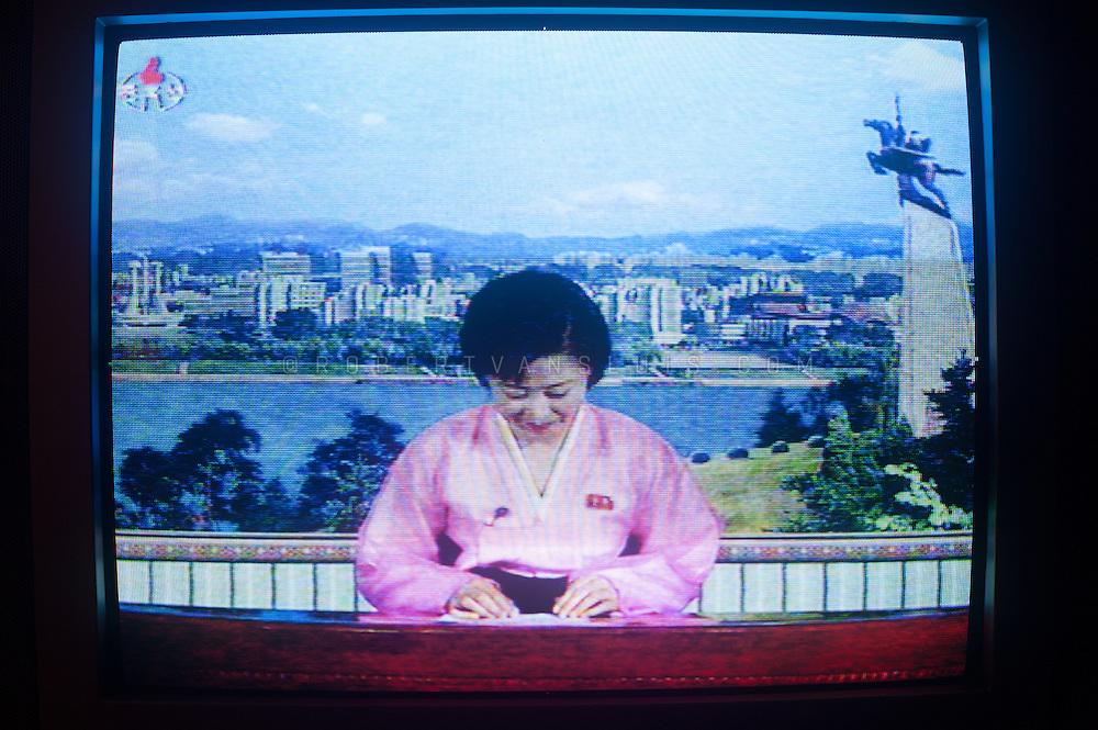 News presenter on North Korean television, DPRK (North Korea)