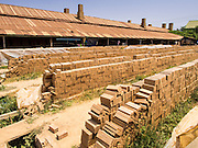 26 FEBRUARY 2015 - PHNOM PENH, CAMBODIA: Bricks dry in the sun before going into the kilns at a brick making factory on the outskirts of Phnom Penh.    PHOTO BY JACK KURTZ