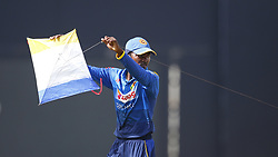 August 31, 2017 - Colombo, Sri Lanka - Sri Lankan cricketer Akila Dananjaya carries away a kite which landed in the playing area during the 4th One Day International cricket match between Sri Lanka and India at the R Premadasa international cricket stadium at Colombo, Sri Lanka on Thursday 31 August 2017. (Credit Image: © Tharaka Basnayaka/NurPhoto via ZUMA Press)