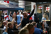 England supporters walk towards Leicester Square and pass restaurants, which encouraged other people to start chanting.  03.07.2021. Marcin Riehs/Pathos