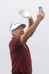 June 12, 2019 - Pebble Beach, CA, U.S. - PEBBLE BEACH, CA - JUNE 12: PGA golfer Ian Poulter takes a selfie while playing the 18th hole during a practice round for the 2019 US Open on June 12, 2019, at Pebble Beach Golf Links in Pebble Beach, CA. (Photo by Brian Spurlock/Icon Sportswire) (Credit Image: © Brian Spurlock/Icon SMI via ZUMA Press)