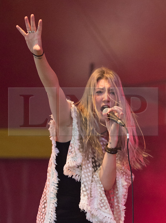 © Licensed to London News Pictures. 30/08/2015. Reading, UK. Queen Kwong performing at Reading Festival 2015, Day 3 Sunday.   In this picture - Carré Callaway.   Photo credit: Richard Isaac/LNP