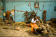 Master craftsman Pranava Stapathy works on a large statue of Hanuman, the monkey God at the workshop of S. Devasenapathy Stapathy and Sons..The current Stpathy family is the twenty third generation of bronze casters dating back to the founding of the Chola Empire. The Stapathys had been sculptors of stone idols at the time of Rajaraja 1 (AD985-1014) but were called to Tanjore to learn bronze casting. Their methods using the ,ƒÚlost wax,ƒÙ process remains unchanged to this day.