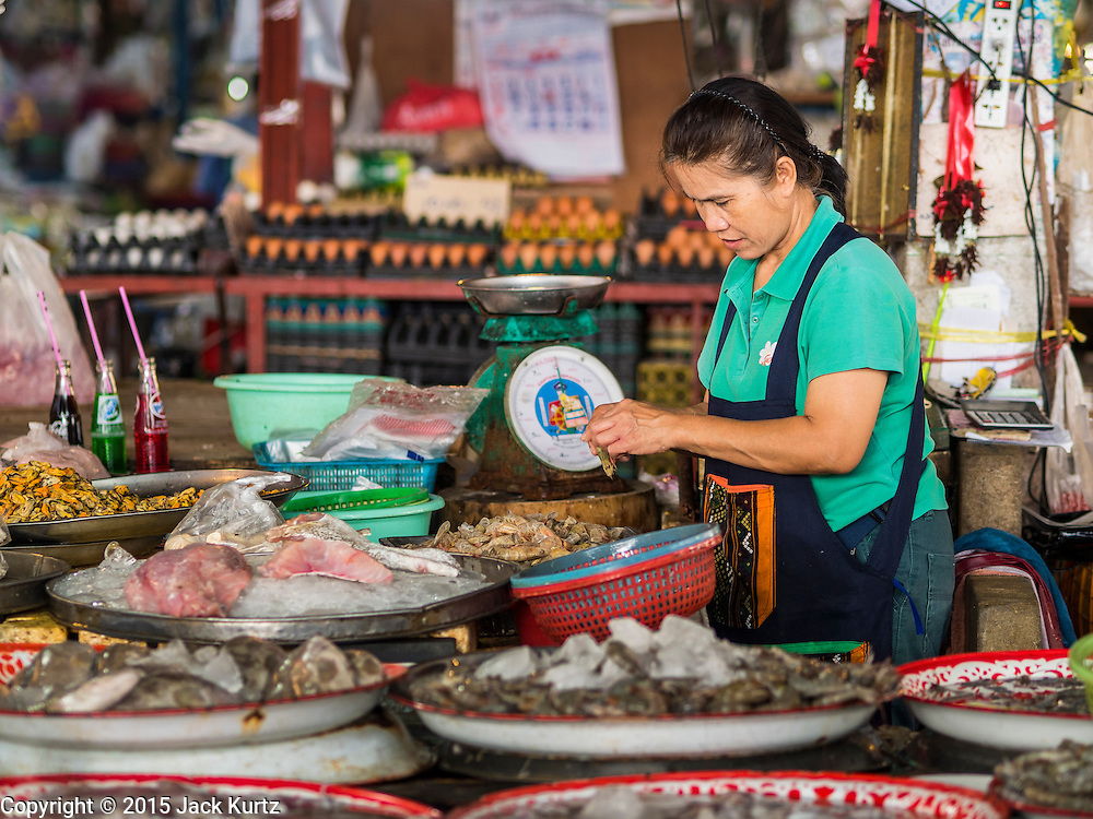 02 SEPTEMBER 2015 - BANGKOK, THAILAND: A woman selling shrimp in the Bang Chak Market. The Bang Chak Market serves the community around Sois 91-97 on Sukhumvit Road in the Bangkok suburbs. About half of the market has been torn down, vendors in the remaining part of the market said they expect to be evicted by the end of the year. The old market, and many of the small working class shophouses and apartments near the market are being being torn down. People who live in the area said condominiums are being built on the land.         PHOTO BY JACK KURTZ