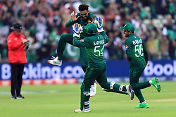 Pakistan's Mohammad Amir celebrates taking the wicket of New Zealand's Martin Guptill (not in picture) during the ICC Cricket World Cup group stage match at Edgbaston, Birmingham.