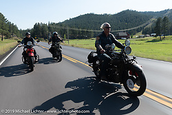 Doug Feinsod riding his Indian with Jody Perewitz and Todd Kraft close behind during the Motorcycle Cannonball coast to coast vintage run. Stage 9 (294 miles) from Pierre to Sturgis, SD. Sunday September 16, 2018. Photography ©2018 Michael Lichter.