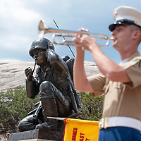 Lance corporal Matthew Peskanov played Taps at Veterans Memorial Park, Wednesday, August 14 in Window Rock during Navajo Code Talkers Day.