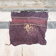 Beggards leave a cloth for people to leave offerings of grains of wheat, at the Jagdish Hindu temple.