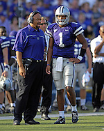 Kansas State head coach Ron Prince talks with quarterback Josh Freeman (1) during a late drive in the fourth quarter against Oklahoma State at Bill Snyder Family Stadium in Manhattan, Kansas, October 7, 2006.  The Wildcats beat the Cowboys 31-27.<br />