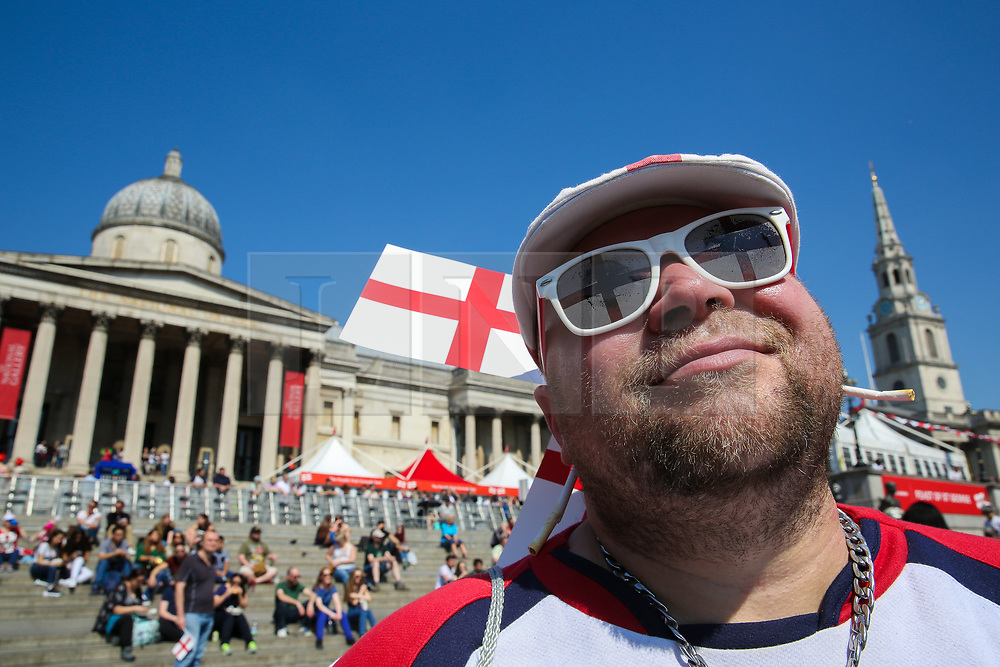 © Licensed to London News Pictures. 20/04/2019. London, UK. A man wearing England Flag design sunglasses attends the annual 'Feast of St George' event in Trafalgar Square, to celebrate the Patron Saint of England. St George's Day is on 23 April. Photo credit: Dinendra Haria/LNP