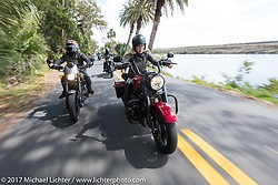 """Iron Lilies Leticia Cline (R) tests the all new 2017 Harley-Davidson Road King Special with its 107"""" Milwaukee-Eight engine alongside custom bike builder Jesse Rooke on a 2014 Harley-Davidson Iron 883 Sportster in Tomoka State Park during Daytona Beach Bike Week. FL. USA. Tuesday, March 14, 2017. Photography ©2017 Michael Lichter."""