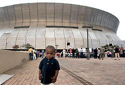 01 January, 2006. New Orleans, Louisiana. Post Katrina aftermath. <br /> New Year's Day in New Orleans, Louisiana. Louisiana Rebirth interfaith service at the Superdome rings out the old disastrous 2005 and rings in what politicians and locals hope will be a successful 2006. A young child wanders around at the back of the service.<br /> Photo; ©Charlie Varley/varleypix.com