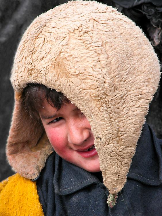 Portrait of an inquisitive village lad in western Tajikistan