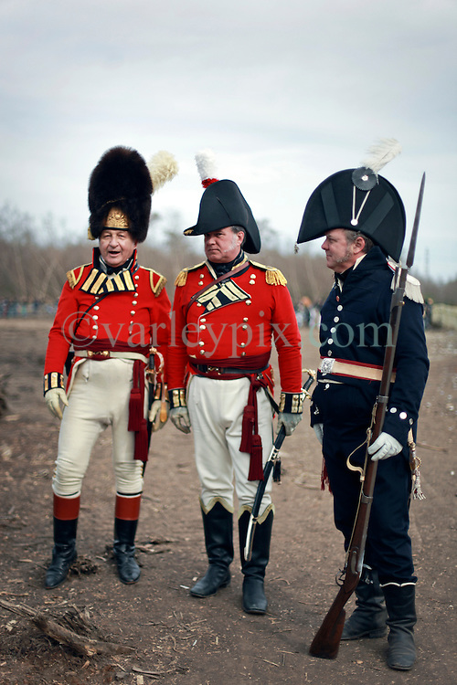 11 January 2015. New Orleans, Louisiana. <br /> Bicentennial reenactment of the Battle of New Orleans in Chalmette. <br /> L/R; Capt Larry Stutt of the 8th Regiment afoot, Major Hal Dennison of the 1st Regiment afoot Royal Scots Guards and Major Dave Bennett of the US 1st Infantry after re-enacting the January 8th, 1815 marking the 200th anniversary of the Battle of New Orleans in Chalmette. Despite heavily outnumbering the Americans, the British suffered over 2,000 casualties, with many senior officers amongst the dead and injured compared to the Americans who suffered a mere 70 by comparison. The American victory was hailed as miracle.<br /> Photo; Charlie Varley/varleypix.com