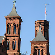 Smithsonian Castle Towers. Towers on the norther face of the Smithsonian Castle on the National Mall (shot from the east looking west). Originally comprising of exhibit and public engagement space, the Smithsonian Castle is now mostly taken up with the institution's administrative offices.