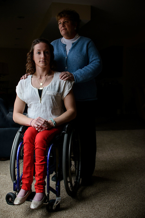 Photo by Matt Roth.Assignment ID: 10136387A..Deborah McFadden stands for a portrait with her daughter Tatyana McFadden, 23, at their home in Clarksville, Marland on Friday, December 21, 2012. Tatyana was adopted from Russia at age 6 with spina bifida. The Paralympic gold medalist, and a group of adopted children, plan to appeal to Russian ambassador.