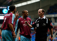 Photo: Jed Wee.<br />Bolton Wanderers v West Ham United. The Barclays Premiership. 11/03/2006.<br /><br />West Ham's Anton Ferdinand (L) and Shaun Newton confront referee Mike Dean.