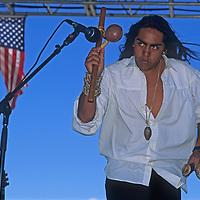 Navajo musician Robert Mirabal plays native instruments at an outdoor concert in Santa Fe.
