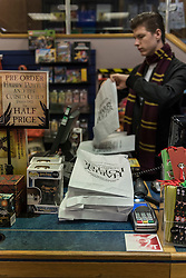 """© Licensed to London News Pictures. 31/07/2016. London, UK.  Shop staff dressed in costume greet fans of the Harry Potter books series visiting Waterstones bookshop in Harrow to buy the """"Harry Potter and the Cursed Child"""", the script, in book form, of the play by JK Rowling. Photo credit : Stephen Chung/LNP"""