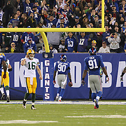 Jason Pierre-Paul, New York Giants, heads for the end zone after picking off Packers Quarterback Scott Tolzien, (left), during the New York Giants Vs Green Bay Packers, NFL American Football match at MetLife Stadium, East Rutherford, New Jersey, USA. 17th November 2013. Photo Tim Clayton