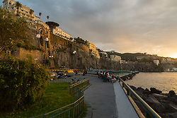 Sorrento, Italy, September 16 2017. The last rays of the sun illuminate the hotels perched on the clifftops in Sorrento, Italy. © Paul Davey