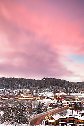 """""""Downtown Truckee Sunset 2"""" - Photograph of a snowy Downtown Truckee with a pink sunset above it."""