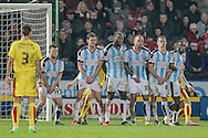 Huddersfield Town put a large wall in front of the Rotherham free kick, just outside the penalty box during the Sky Bet Championship match between Huddersfield Town and Rotherham United at the John Smiths Stadium, Huddersfield, England on 15 December 2015. Photo by Mark P Doherty.