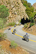 BMW motorcycles carving a canyon near Castaic, California during the 2009 Rawhyde Adventure Rider Challenge.