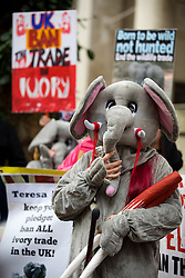 © Licensed to London News Pictures. 16/11/2016. London, UK. Action for Elephants UK hold a demonstration outside the Department for Environment Food and Rural Affairs, calling for the government to ban all ivory trading in the UK. The UK already has a ban on trade in raw tusks, or 'unworked' ivory, of any age, but not in antiques. Photo credit : Tom Nicholson/LNP