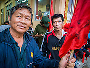 28 APRIL 2014 - BANGKOK, THAILAND: Red Shirt activists watch the funeral for Kamol Duangphasuk, 45, in Bangkok. Kamol was a popular poet who wrote under the pen name Mai Nueng Kor Kunthee. Kamol had been writing since the 1980s and was an outspoken critic of the 2006 coup that deposed Thaksin Shinawatra. After the 2010 military crackdown against the Red Shirts he went into temporary self imposed exile fearing for his safety. After he returned to Thailand he organized weekly protests against Thailand's Lese Majeste laws, which he said were being used to stifle dissent. Kamol was shot and murdered on April 23. The assailants are still at large but the murder is thought to be political.     PHOTO BY JACK KURTZ