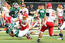 19 September 2015:  Austin Harrell meets the turf courtesy of Abe Wolfe during an NCAA division 3 football game between the Simpson College Storm and the Illinois Wesleyan Titans in Tucci Stadium on Wilder Field, Bloomington IL