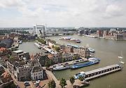 View over rooftops and Oude River Maas to railway bridge, Dordrecht, Netherlands