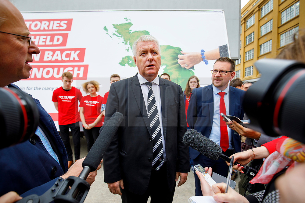 © Licensed to London News Pictures. 11/05/2017. London, UK. Labour campaign coordinators IAN LAVERY and ANDREW GWYNNE unveil Labour party's new election campaign poster in South Bank, London after Labour leader Jeremy Corbyn pulled out of the event following the manifesto leak on 11 May 2017. Photo credit: Tolga Akmen/LNP